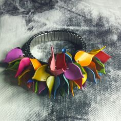 Silver  stretch bracelet with clay colorful leaves by Miss D