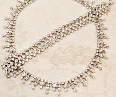 "Vintage Kramer of NY Rhinestone Bib Necklace Bracelet Demi is lovely.  The necklace is designed with marquis shaped ""stones"" that ""drip"" from the single row of rhinestones, very delicate and feminine"