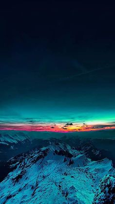 Sunset on top of a mountain. Blues and reds. Landscape. High mountains, sky.
