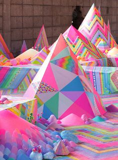 When an artist'smedium involves a florescent spectrum of sugar, glitter, candy, pom poms, pipe cleaners, and washi tape, you know it's going to be magical. Australian artist Tanya Schultz, who works under the pseudonym Pip & Pop, meticulously creates herfantastical, utopian wonderlands all