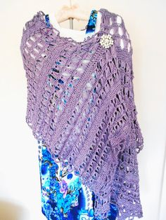 This delicate, lacy wrap was made just for you during those spring time evenings with just a hit of winter left over. This beautiful lace shawl is