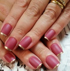 Gold and rose themed French tips. A fairly attractive looking color combination where you paint a thin strip of gold nail polish for your French tips while it complements the rose colored base color.