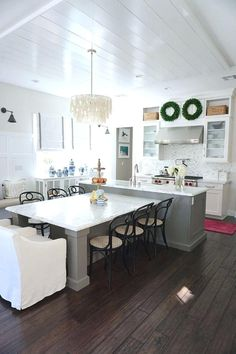 The Center Island Has A Built In Table That Seats 8 And Features Carrrara Honed Marble Counter T Shaped Kitchen With