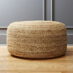 Shop braided hemp jute pouf.   Spontaneous seating rounds out the room in coiled braids of light and natural jute.  Dense poly-fill makes pouf sturdy for seat/ottoman duty.  Or, top it with a tray when guests pop in.