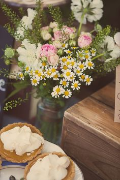 Jar of seasonal wedding flowers