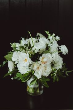 modern white bouquet with greenery - photo by Amber Gress http://ruffledblog.com/modern-brooklyn-wedding-at-the-wythe-hotel