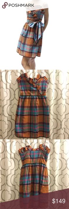 "Thread Social Madras Plaid Sweetheart Dress Jennifer Lawrence loves this Thread Social pattern and you should too! Orange and pink madras Plaid dress. Sweetheart neckline with ruffles. Hidden side zip closure. Side pockets on both hips. No Belt included. Spaghetti straps. Black trim along bottom hem. Approx 15"" across bust, 12.5"" across waist, 33"" shoulder to hem. No signs of wear. EUC.   No trades. If I want something in your closet, I'll buy it 😍 Reasonable offers always welcome! Thread…"