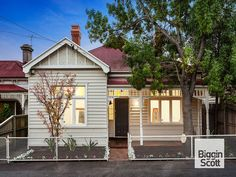 Cream and white Victorian house with red roof. 8 Park Grove, Richmond, Vic 3121