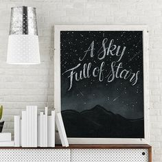 This poster is inspired by Coldplays A Sky Full of Stars from the album Ghost Stories. Its hand-lettered with charcoal on a black illustration