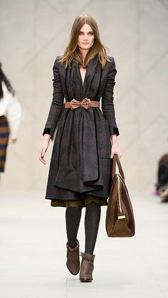 The Burberry show was so feminine this year, I loved it. Love the belt, love the coat.
