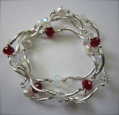 This is my family bracelet, January (garnet), April (clear AB), June (pearl), and October (opal). These crystal bracelets make an affordable mother/grandmother bracelet! Only $10.00 for this combination. We have them in all of the birthstone colors.