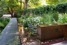 A River Runs Through It - Urban garden in Toronto - Remodelista Pergola Garden, Deck With Pergola, Diy Pergola, Backyard Landscaping, Wooden Pergola, Pergola Ideas, Backyard Stream, Wooden Walkways, Backyard Ponds