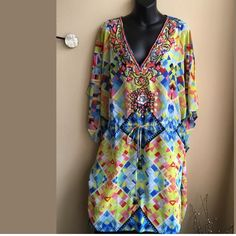 Beaded cover up/ tunic Brand new tunic / cover up . Wear it over your swimsuit or pair it with leggings . Beautiful bright colors . Drawstring at waist . Swim Coverups