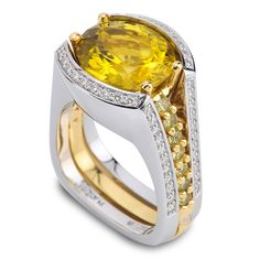 Interlude 150-R55:  4.78ct Oval Yellow Tourmaline accented by Garnets and Diamonds set in 18K Green Gold and Platinum.