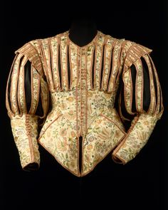 Doublet, early 1620s, French, silk. Made of luxurious silk embellished with pinking and decorative slits, this doublet followed a fashion that existed barely five years. Pinking, or the intentional slashing of fabric, was a popular decorative technique used to reveal colorful linings, shirts, and chemises. It is possible that this garment was constructed from silk previously pinked for another use as the pattern created does not follow the cut of the garment.