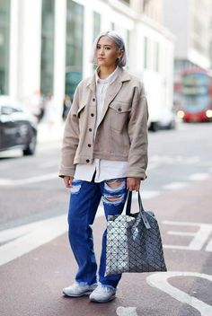 Erika Bowes wears H&M jacket, Topshop Boutique shirt, Marques Almeida jeans, Issey Miyake bag, Adidas trainers.  LC:M S/S 2016 Mens Street Style. London.
