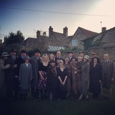 tragic-cranky-porcelain-doll:  Adorable group shot of the Downton Abbey cast filming in Lacock Village (x)Aww, look at Cora and Robert and Anna and Bates! And Thomas and Andy smirking from under their flatcaps makes me happy. :D