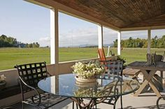 This porch has a spectacular view of Vermont scenery. More from this house in the August 2013 issue. #porch #earlyamericanlife