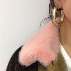 Thick gold hoop earrings, earring trend, statement earrings