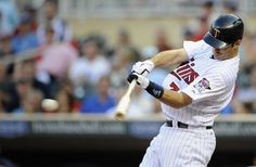 \ Joe Mauer #7 of the Minnesota Twins hits an RBI single against the Baltimore Orioles during the first inning on July 16, 2012 at Target Field in Minneapolis, Minnesot