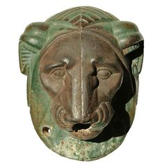 Late 19th Century Cast Iron Lion Fountain Fragment  American  late 19th century  Highly stylized cast iron lion's head fountain fragment with original green paint surface.