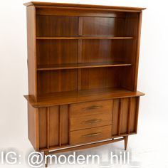 Kent Coffey Foreteller Mid Century Walnut China Cabinet Buffet and Hutch This China Cabinet is 53.25 Wide and 17 Deep by 67.5 Inches Tall The price on our website includes getting this piece in Restored Vintage Condition. This means the piece is restored upon purchase so it's free of watermarks, chips or deep scratches with color loss - all at no additional cost to you, but it takes a bit longer to ship if you choose to have it restored.