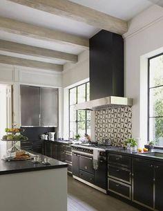 A graphic backsplash energizes the sleek black-and-white Kitchen of this modern Los Angeles Villa. -Veranda