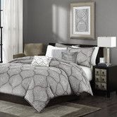 Found it at AllModern - Amara 6 Piece Duvet Cover Set  Also very pretty, especially the close up picture. Comes with the three pillows.