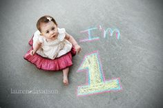 Vintage photo with chalk. Unique and fun one year old birthday photos. One year old photos. 1 year old girl photo ideas. Lauren Davidson Photography.