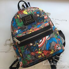 "MARVEL PRINTED FAUX LEATHER MINI BACKPACK. WITH EXTERIOR SIDE POCKETS. MEASUREMENTS: W: 9"" X H: 10.5"" X 4.5"" BY LOUNGEFLY"