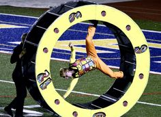 Madison guard ending the show on the wheel @DCI #dci2014 #indianamarching #drumcorpsroadtrip @MadisonCorps pic.twitter.com/px43XsvqYA
