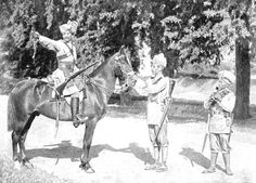 A Scout of the Guides' Cavalry warning his Infantry Comrades. The small man on the right is a Gurkha 1905