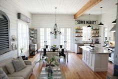 This adorable farmhouse was designed by Magnolia Homes located in Texas, United States. They used functional objects to decorate this lovely place and brick floor, faux door panel, distressed wood for art on walls are the other noteworthy features of this house.