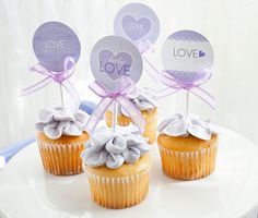 Cupcakes: If five cakes werent enough, cute cupcakes were also available, topped with signs that are part of Frog Prince Paperies baby love printable package.