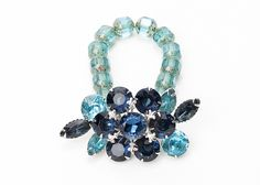 Vienna Love Cures Bracelet --    Antique brooch created into a one of a kind stretch bracelet using vintage beads. A truly stunning piece of arm candy from our Wear a Bracelet, Find a Cure Campaign. -- $75.00