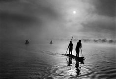 Sebastião Salgado, In the Upper Xingu region of Brazil's Mato Grosso state, a group of Waura Indians fish in the Puilanga Lake near their village. Brazil. 2005. © Sebastião Salgado/Amazonas images—Contact Press Images.