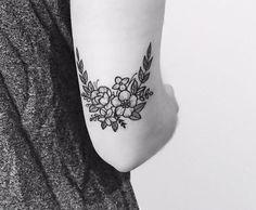 Flowers arch on back of elbow #armtattoosmeaning #bigtattoosonback