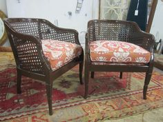 cane chairs in brown high gloss with coral ikat fabric from kravet