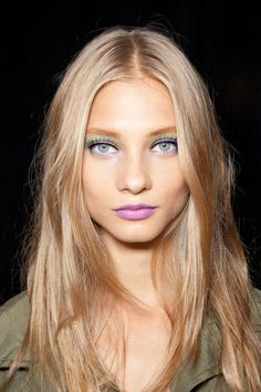 Pops of pastels, highlighting the eyes and lips.