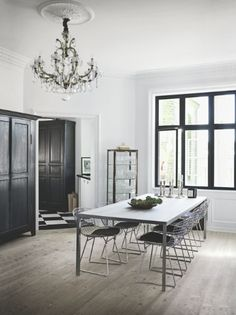Black doors and windows turn this room into an amazing space. Without it's just a big room but that considered detail gives the wow factor.