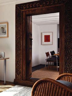 Incredible carved wood doorway from India in a 17th century rural cottage {featured in Homes & Gardens February issue}.