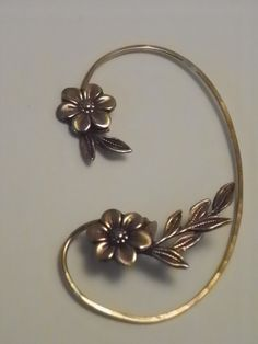 Flower and Leaf  Ear Wrap - GOLDEN GARDEN - Brass Ear Cuff Wrap. $38.95, via Etsy.