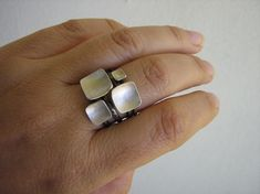 These stack rings are so simple yet very elegant as a cluster.. The square shape of these stacking rings is a bit soft-square for an organic taste and easy use. I hammered them into a bowl shape. I must admit I can not stop myself playing with the possibilities of the combination every