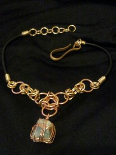 Womens necklace of chainmaille, aquamarine, and a vintage brass hook clasp. Handcrafted, one of a kind.