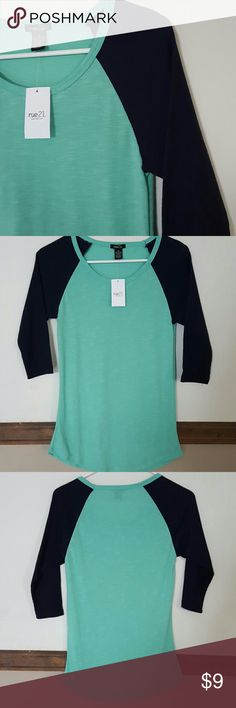 2-toned   1/2 sleeve ?Arms are a knitted material  ?Sleeves are a dark blue  ?Longer than a regular tee but not super long  ?60% cotton, 40% polyester Rue21 Tops Tees - Long Sleeve