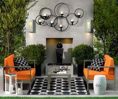 Decorating Ideas for Modern Outdoor Space of Living Room with Contemporary Silver Stainless Steel Materials Sofa Frame that have Warm Orange Seat Cushions also Simple Rectangle Shaped Gray Wood Table on the Black and White Rug, Outdoor Space Decorating Ideas for Inspire You: Exterior