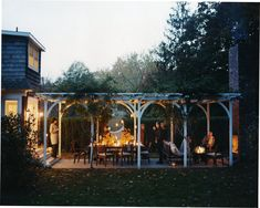 arbor covered space. outdoor fireplace.