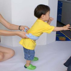 An easy way to help support a child's early walking skills without holding on o their hand.