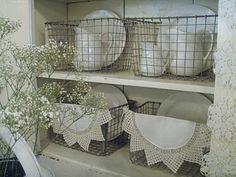 white ironstone in galvanized tin baskets
