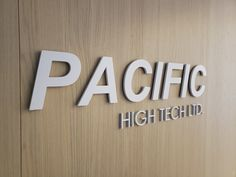 """Custom cut aluminium logo painted white for """"Pacific High Tech Ltd"""" ,distributor of high performance, high quality plastic resins and chemicals. Operating 40 warehouses throughout USA and Canada. Plastic Resin, Resins, Warehouses, Toronto, Canada, Tech, 3d, Logos, Painting"""